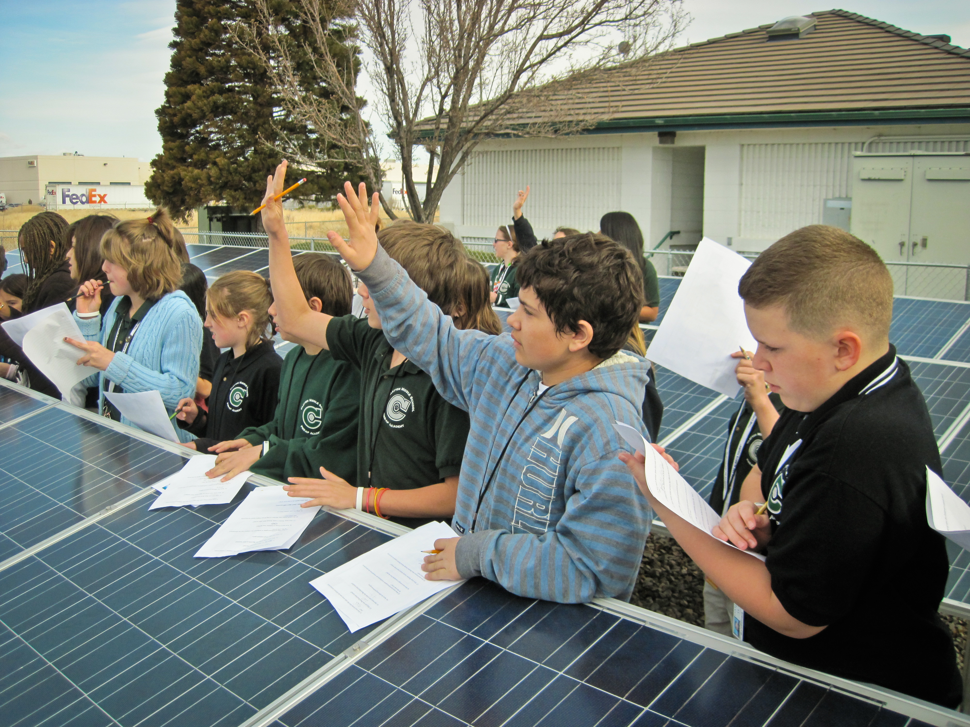 Children learn about solar panels Image